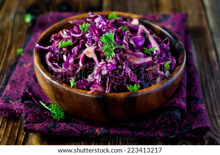 Red cabbage salad with prunes - stock photo
