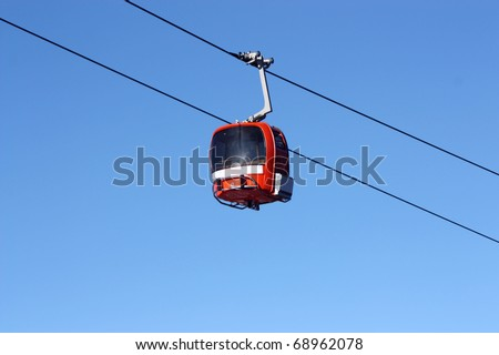 Red cabin lifts at a ski resort - stock photo