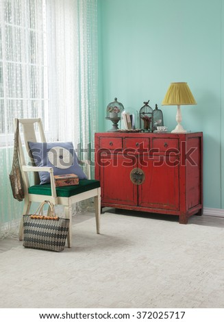 red cabinet asian living room interior with green wall - stock photo