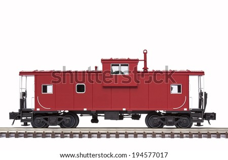 Red Caboose On Railroad Track - stock photo