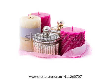 red candles and jewelry boxes on a white background - stock photo