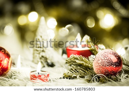 red candles with christmas balls in atmospheric light - stock photo