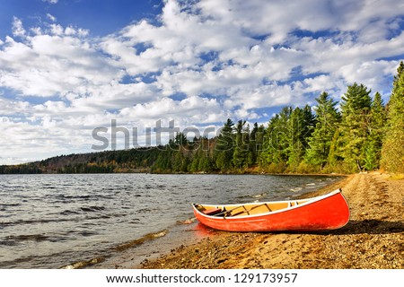 Red canoe on beach at Lake of Two Rivers, Ontario, Canada - stock photo