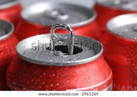 Red Cans of soft drink or beer - stock photo