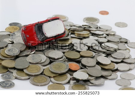 Red car accident on a pile of money white background. to pay damages. - stock photo