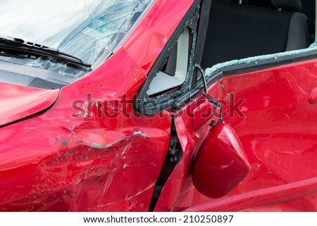red car in an accident - stock photo