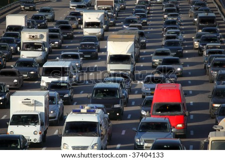 red car in big urban traffic - stock photo