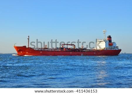 Red cargo ship (tanker) is sailing near Vlissingen, the Netherla - stock photo