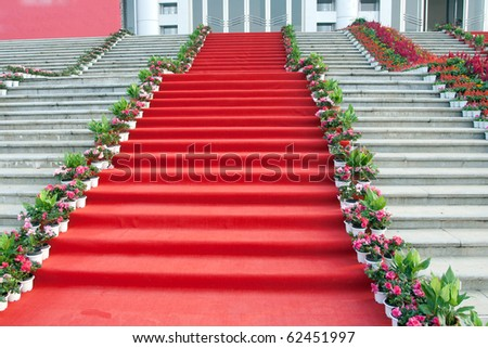 red carpet and marble staircase - stock photo