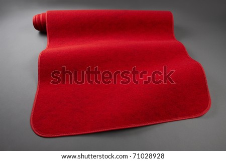 Red carpet rolls out includes space for copy - stock photo