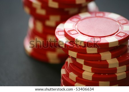 Red casino chips - stock photo