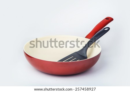 Red ceramic pan for frying - stock photo