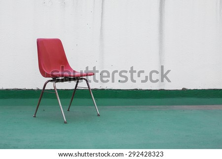 Red Chair vintage in front wall - stock photo