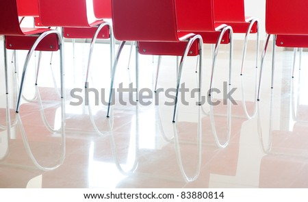 red chairs in ordinary empty waiting room. - stock photo