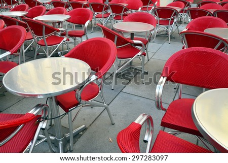 red chairs on the terrace - stock photo