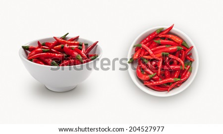 red chili  in a small bowl,  isolated on white background, view from front and top - stock photo