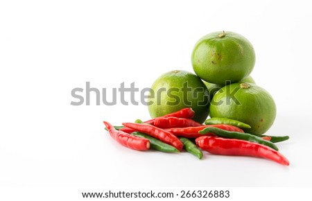 Red chili pepper and green lemon - stock photo