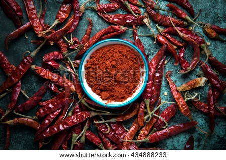 Red chili pepper,dried chillies on dark background. top view - stock photo