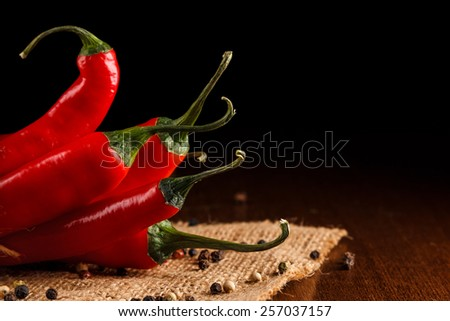 Red chili pepper on a sackcloth - stock photo