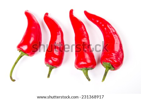 Red chili pepper on white background - stock photo