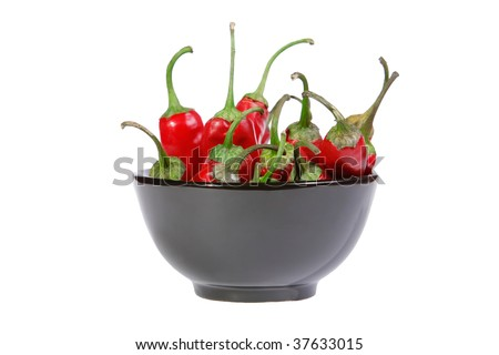 Red chili peppers in a black bowl isolated - stock photo