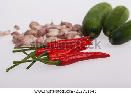 red Chilli peppers with garlic and Cucumber - stock photo