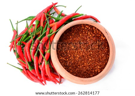 red chillies with red chilly powder on white background - stock photo
