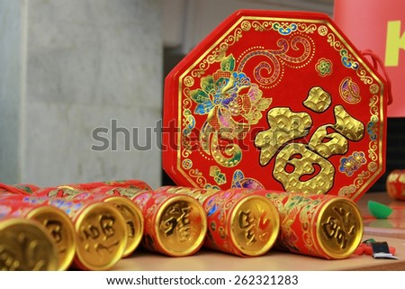 Red Chinese New Year party poppers - stock photo