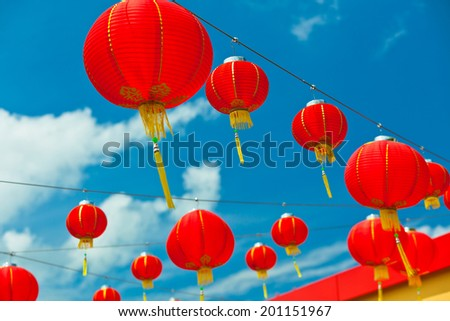 Red Chinese Paper Lanterns against a Blue Sky. Horizontal shot - stock photo