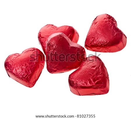 Red chocolate hearts candies on white - stock photo
