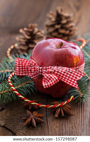 red christmas apple with bow - stock photo