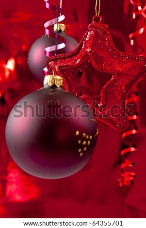 Red christmas background from baubles and ribbons - stock photo