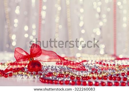 Red Christmas ball and beads - stock photo