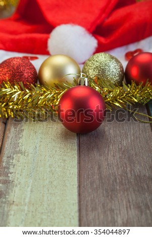 Red christmas ball decoration on grunge wooden floor - stock photo