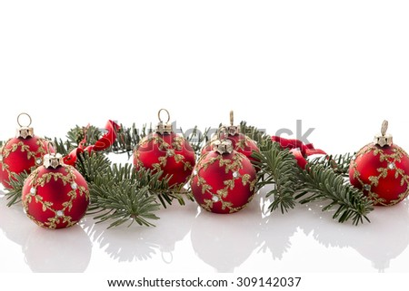 red christmas ball decorations and fir tree on white background - stock photo