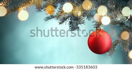 Red Christmas ball hanging on Christmas tree. - stock photo