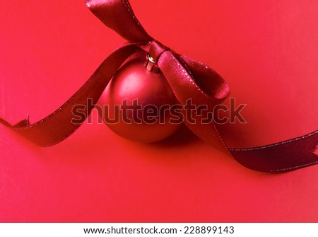 Red christmas ball, isolated on red background. - stock photo