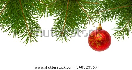 Red christmas ball on fir branch isolated on white background.Christmas ball on green spruce branch - stock photo