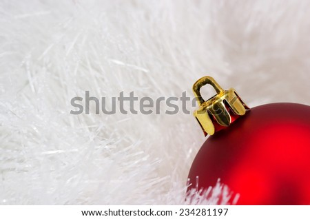 Red christmas ball on the defocused background of tinsel - stock photo