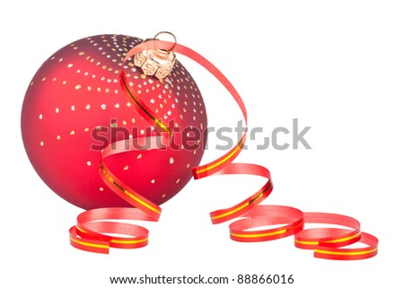 Red christmas ball with ribbon and confetti - stock photo