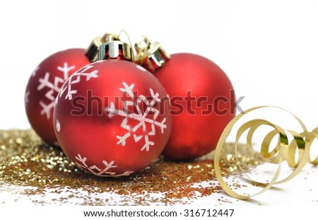 Red christmas balls and gold glitter on white background - stock photo