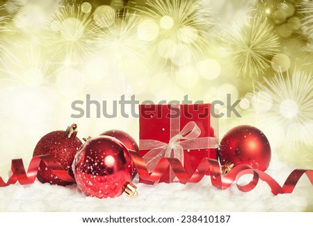 Red christmas balls on bokeh holiday background  - stock photo