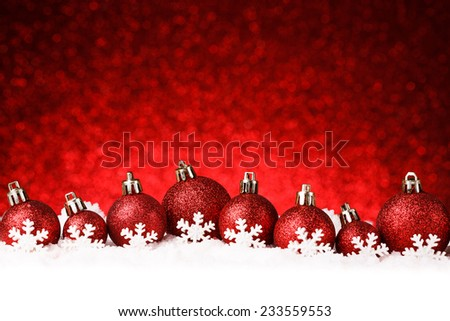 red christmas balls on snow. studio shot - stock photo