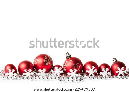 red christmas balls on white. studio shot - stock photo