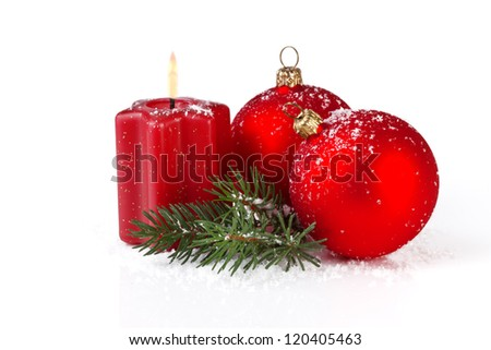 red christmas balls with candle, isolated on white background - stock photo