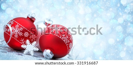 Red Christmas balls with decoration on shiny background - stock photo