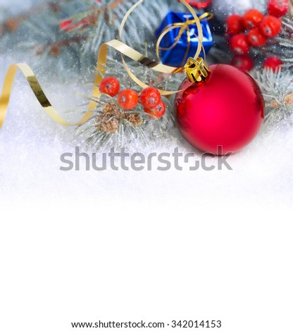 Red christmas bauble with fir,rowan,golden ribbon on white background with space for text.New Year wallpaper. - stock photo