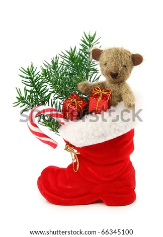 Red christmas boot with gift boxes and teddy bear isolated on white background - stock photo