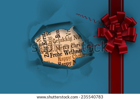 Red christmas bow and ribbon against circle hole in paper - stock photo