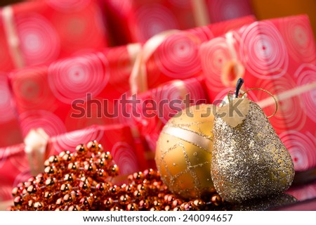 red Christmas gift boxes and gold ball and garland - stock photo